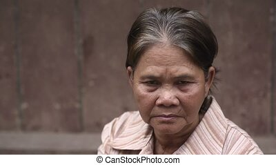 Portrait of serious old asian woman