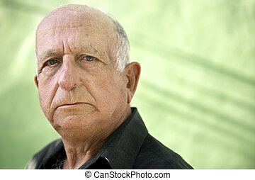 Portrait of serious old hispanic man looking at camera -...