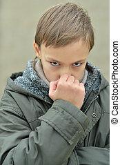 serious thinking boy