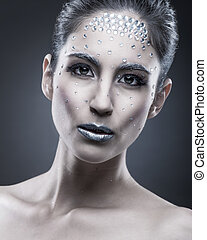 Portrait of sexual beautiful girl with crystal on face