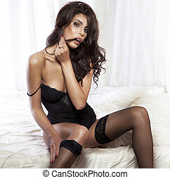 Portrait of sexy attractive beauty looking at camera.