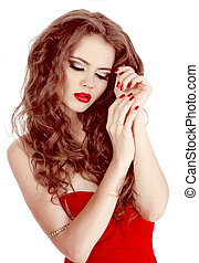Portrait of sexy beautiful woman in red dress with make-up and curl hairs