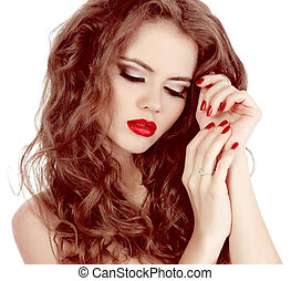 Portrait of sexy beautiful woman with red manicure nails, make-up and curl hairs