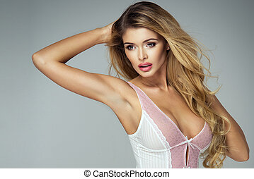 Portrait of sexy blond woman wear pastel lingerie