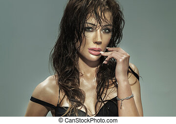 Portrait of sexy brunette woman looking at camera.
