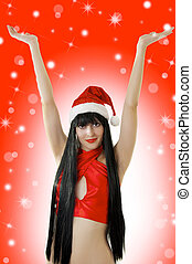 Portrait of sexy female model in santas hat