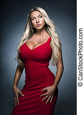 Portrait of sexy woman in red dress