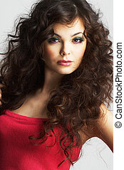 Portrait of sexy woman with beautiful make-up and long curly...