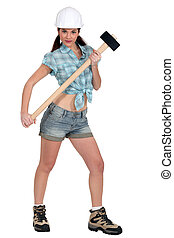 Portrait of sexy woman with hammer
