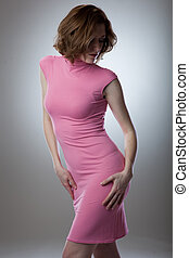 Portrait of sexy young woman in pink dress