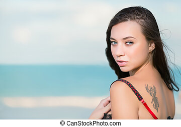 Portrait of sexy young woman with tattoo