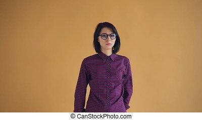 Portrait of shocked brunette in glasses feeling bad after...