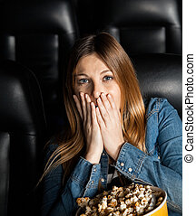 Portrait Of Shocked Woman At Cinema Theater