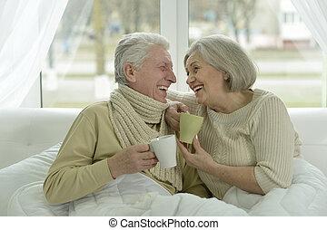 sick  elderly couple in bed