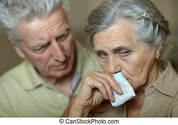 sick senior couple with handkerchief - Portrait of sick ...