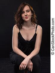 Portrait of sitting brunette woman