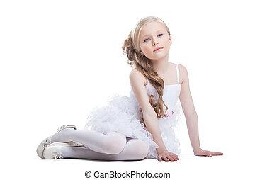 Portrait of sitting pretty girl in white dress