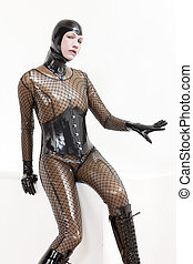 portrait of sitting woman wearing latex clothes