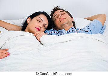Portrait of sleeping young couple