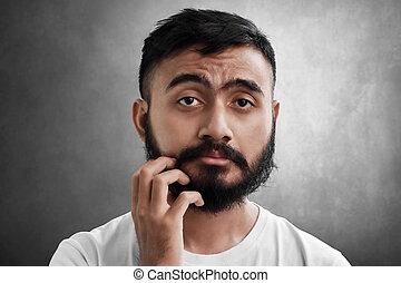 Portrait of sleepy bearded man