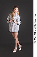 slim girl in a shirt