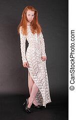 slim girl in a white dress