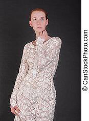 slim girl in white dress