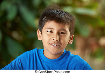Portrait of small hispanic boy
