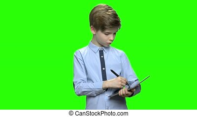 Portrait of smart boy drawing on tablet pc.