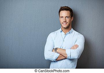 Portrait Of Smart Man Against Gray Background