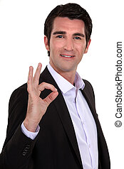 portrait of smart man making okay sign