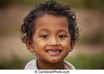 Portrait of smile asian poor girl in Thailand