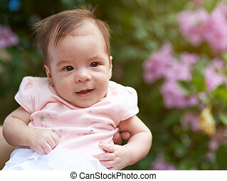 Portrait of smiled baby girl