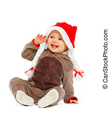 Portrait of smiling adorable baby in Santa hat