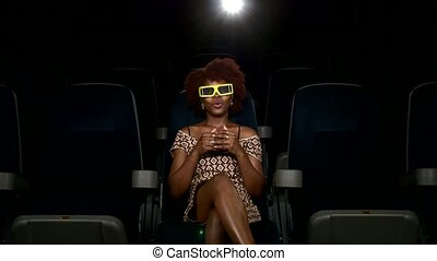 Portrait of smiling African American watching movie in theater. 3D glasses