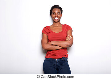 smiling african american woman standing with arms crossed on white background
