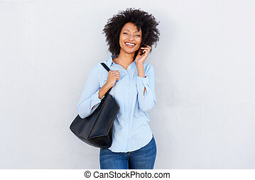 smiling african american woman talking on cellphone