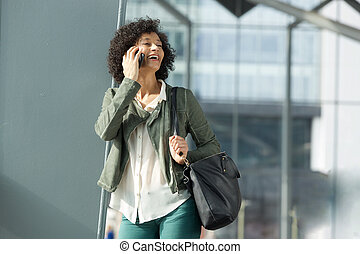 smiling african american woman talking on smart phone