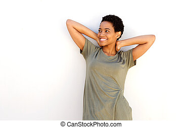 smiling african american woman with hands behind head