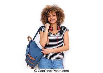 smiling african american young woman with bag against white background