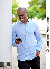 smiling african businessman with cellphone