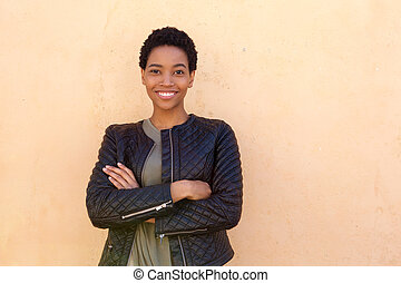 smiling african woman with black jacket
