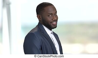 Portrait of smiling afro-american businessman. Flirtatious...