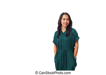 Portrait of smiling asian woman standing while looking at a camera. Isolated on white background with copyspace