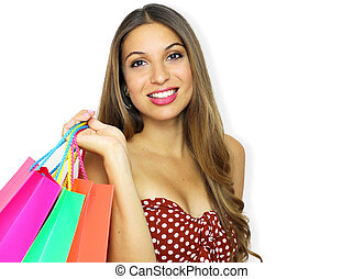 Portrait of smiling beautiful fashion girl with shopping bags looking at camera on white background. Copy space.