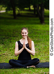Portrait of smiling beautiful sporty young woman working out...