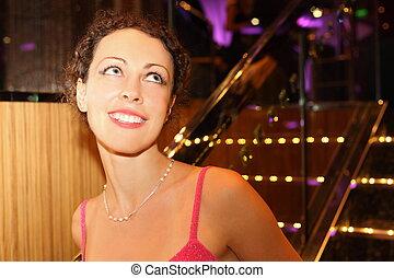 portrait of smiling beautiful woman wearing evening dress.