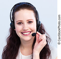 Portrait of smiling beautiful woman with a headset on