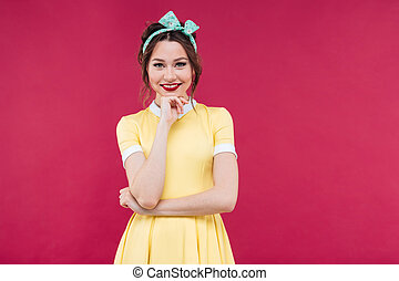Portrait of smiling beautiful young woman in yellow dress