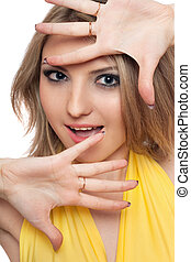 Portrait of smiling beautiful young woman. Isolated